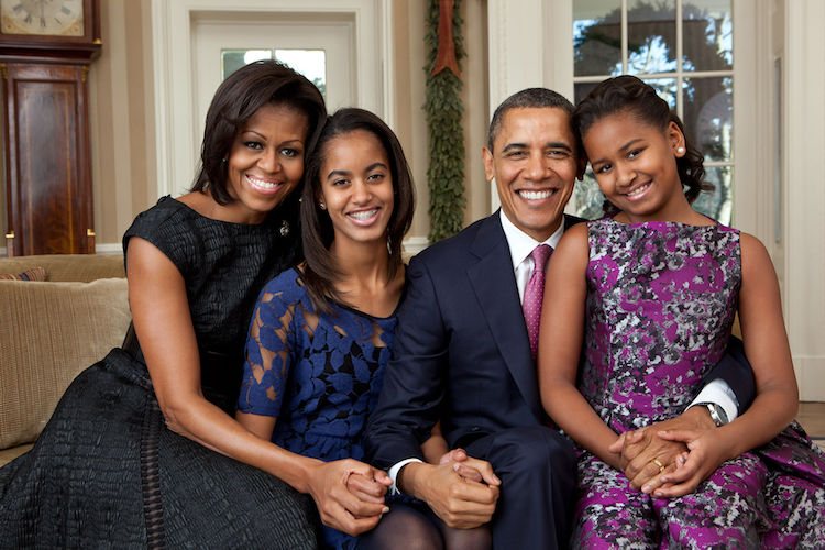 Photo: Official portrait by Pete Souza of the Obama family in the Oval Office in 2011. (From L-R): Michelle Obama, Malia Obama, Barack Obama, and Sasha Obama.