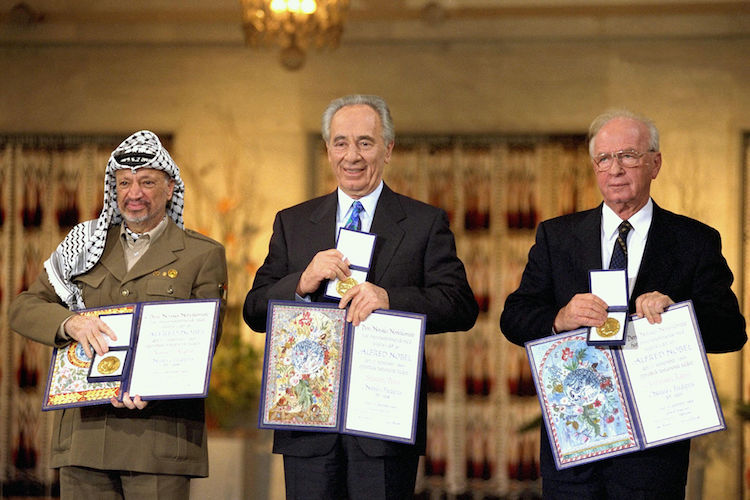 Photo: The Nobel Peace Prize laureates for 1994 in Oslo. From left to right: PLO Chairman Yasser Arafat, Israeli Foreign Minister Shimon Peres, Israeli Prime Minister Yitzhak Rabin. Credit: Saar Yaacov, GPO - Government Press Office, Israel | Wikimedia Commons