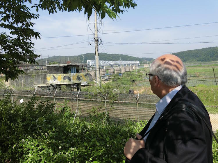 Photo: Ramesh Jaura trying glancing an important bridge in post-war Korean Peninsula history