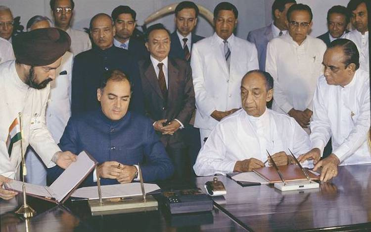 Photo: Prime Minister Rajiv Gandhi and Sri Lankan President J.R. Jayewardene sign the historic Indo-Sri Lanka accord in Colombo on July 29, 1987. File photo. Courtesy of The Hindu.